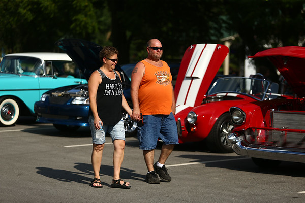 Lori Wooten and Bruce Ehase check out the classic cars during the Haynes Apperson Festival on Thursday, June 28, 2018.<br /> Kelly Lafferty Gerber   Kokomo Tribune