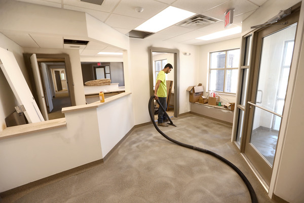 Enrique Lopez, from Rite-Way, works on the floors inside the Kokomo Humane Society as it nears the completion of construction on June 28, 2018.<br /> Kelly Lafferty Gerber   Kokomo Tribune