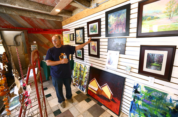 Avon Waters, surrounded by his art in his Amboy gallery, talks about some of his paintings on June 7. <br /> Kelly Lafferty Gerber   Kokomo Tribune
