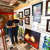 Avon Waters, surrounded by his art in his Amboy gallery, talks about some of his paintings on June 7. <br /> Kelly Lafferty Gerber | Kokomo Tribune