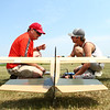 Larry Blanton, left, and Austin Morris work together to try and repair Blanton's radio control plane at the Converse Airport on Saturday. The Converse Flying Eagles R/C Club met at the Converse Airport for the annual egg drop competition.<br /> Kelly Lafferty Gerber | Kokomo Tribune