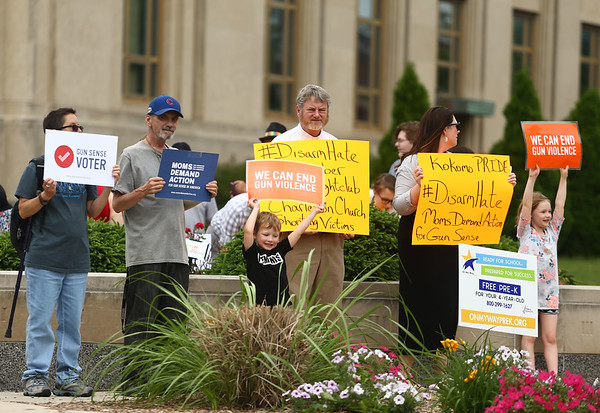 """Attendees of the """"Disarm Hate Vigil"""" at the Howard County Courthouse on Tuesday, June 12, 2018, hold signs urging the end of gun violence.<br /> Kelly Lafferty Gerber 