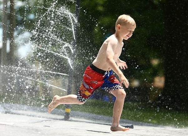 Chance King, 6, splashes through the water spray at Highland Park on Wednesday, June 27, 2018.<br /> Kelly Lafferty Gerber | Kokomo Tribune