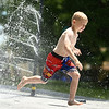 Chance King, 6, splashes through the water spray at Highland Park on Wednesday, June 27, 2018.<br /> Kelly Lafferty Gerber | Kokomo Tribune