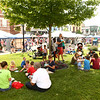 Strawberry Festival attendees take advantage of the shade in front of the Howard County Courthouse to eat their strawberry shortcake dessert in downtown Kokomo on Friday, June 1, 2018.<br /> Kelly Lafferty Gerber | Kokomo Tribune