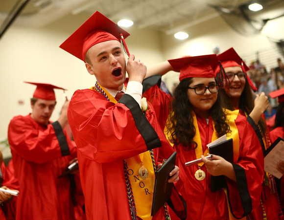 Stephen Markley cheers as he turns his tassel at the end of the Taylor High School graduation on Friday, June 8, 2018.<br /> Kelly Lafferty Gerber | Kokomo Tribune