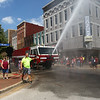 To the delight of the crowd, an Air Force fire truck sprays water on the Haynes Apperson parade-goers on Saturday, June 30, 2018.<br /> Kelly Lafferty Gerber | Kokomo Tribune