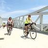 Bikers cross the Nickel Plate trail bridge after it was officially opened on Friday, June 29, 2018.<br /> Kelly Lafferty Gerber | Kokomo Tribune