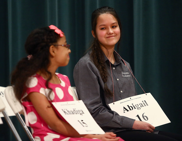 Western Middle School 8th-grader Abigail Origer exchanges a smile with Western Intermediate School 4th-grader Khadiga Moawid after the North Central Indiana Regional Spelling Bee is narrowed down to just the two of themon Thursday, March 22, 2018. Origer went on to win the Bee and Moawid was runner-up.<br /> Kelly Lafferty Gerber | Kokomo Tribune