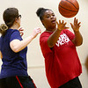 Shantina Holiday makes a pass as the Howard County Special Olympics girls basketball team practices on Tuesday, March 6, 2018, for their upcoming state finals game.<br /> Kelly Lafferty Gerber | Kokomo Tribune