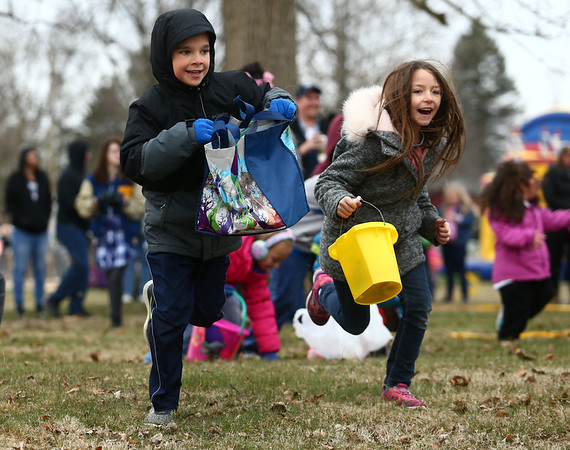 Kids sprint to find eggs during the easter egg hunt at Fuel Church's Easter Festival on Saturday, March 31, 2018.<br /> Kelly Lafferty Gerber | Kokomo Tribune