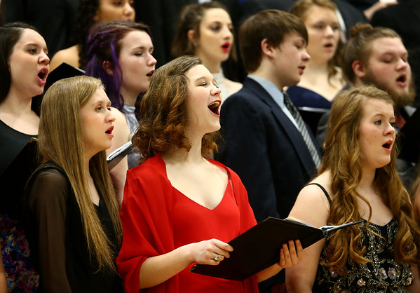 Eastern's Ruth Martin sings with choirs from Eastern, Western, Northwestern and Taylor High Schools during their performance together during the Howard County Music Festival at Eastern High School on Wednesday, March 14, 2018.<br /> Kelly Lafferty Gerber | Kokomo Tribune
