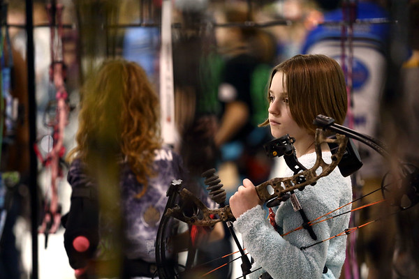 Karly Froehlke, 9, waits with her bow for the whistle announcing the next round of the 53rd annual Indiana Field Archery Association Indoor Tournament at the Kokomo Event Center on Saturday, March 3, 2018. Froehlke, from La Porte, Indiana, has been shooting for just a few days.<br /> Kelly Lafferty Gerber | Kokomo Tribune