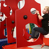 Easton Off, 6, climbs through the swiss cheese walls without touching the mat as he moves through the course during the Ninja Zone class at Kokomo Flipsters on Tuesday, March 13, 2018.<br /> Kelly Lafferty Gerber | Kokomo Tribune