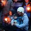 Kassie Koontz holds her son Noah as the two, surrounded by friends, family and supporters holding candles, remember Koontz's husband, Deputy Carl Koontz, 2 years after he was shot and killed. Deputy Carl Koontz's  memorial was at Albright Cemetery on Tuesday, March 20, 2018.<br /> Kelly Lafferty Gerber | Kokomo Tribune