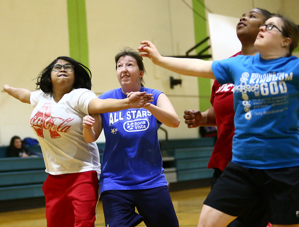 The Howard County Special Olympics girls basketball team practices blocking out on Tuesday, March 6, 2018, for their upcoming state finals game.<br /> Kelly Lafferty Gerber | Kokomo Tribune