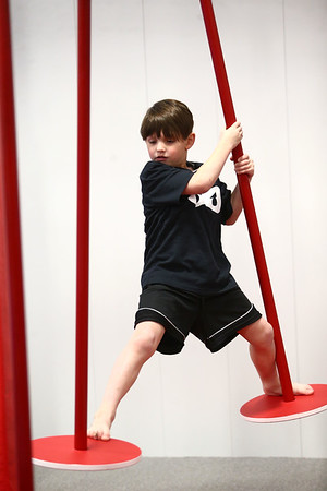 Owen Snyder, 6, maneuvers from one swing pole to another as he goes through the course during his Ninja Zone class at Kokomo Flipsters on Tuesday, March 13, 2018.<br /> Kelly Lafferty Gerber | Kokomo Tribune