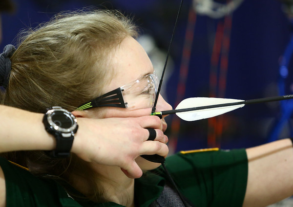 Elaina Wahlman, 14, of Seymour, Indiana draws back her bow and arrow during the 53rd annual Indiana Field Archery Association Indoor Tournament at the Kokomo Event Center on Saturday, March 3, 2018.<br /> Kelly Lafferty Gerber | Kokomo Tribune