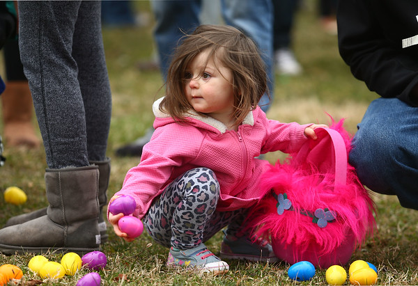 2-year-old Natalya Schmidt grabs a couple of eggs to put into her Trolls easter basket during Fuel Church's Easter Festival on Saturday, March 31, 2018. Kelly Lafferty Gerber | Kokomo Tribune