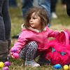 2-year-old Natalya Schmidt grabs a couple of eggs to put into her Trolls easter basket during Fuel Church's Easter Festival on Saturday, March 31, 2018.<br /> Kelly Lafferty Gerber | Kokomo Tribune