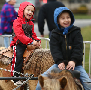Youngsters enjoy the pony rides during Fuel Church's Easter Festival on Saturday, March 31, 2018. Kelly Lafferty Gerber | Kokomo Tribune