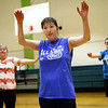 Brooke Sawyer gets the team warmed up with jumping jacks and arm circles at the start of practice for the Howard County Special Olympics girls basketball team on Tuesday, March 6, 2018.<br /> Kelly Lafferty Gerber | Kokomo Tribune