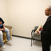 Dr. Edgar Martinez talks with patient Angela Smith at the Lafayette Pain Care medical clinic inside what used to be a Walgreens on the corner of Sycamore and Washington on Friday, March 30, 2018.<br /> Kelly Lafferty Gerber | Kokomo Tribune