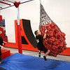 With the help of instructor Brittany Yard, 6-year-old Jayce Bryant swings along the zipline at Ninja Zone class course at Kokomo Flipsters on Tuesday, March 13, 2018.<br /> Kelly Lafferty Gerber | Kokomo Tribune