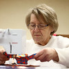 Susan Burns sews with the local Days for Girls group on International Women's Day, Thursday, March 8, 2018. The group was working at the Kokomo-Howard County Public Library south branch to create washable hygiene solutions for girls during their monthly menstrual cycles.<br /> Kelly Lafferty Gerber | Kokomo Tribune