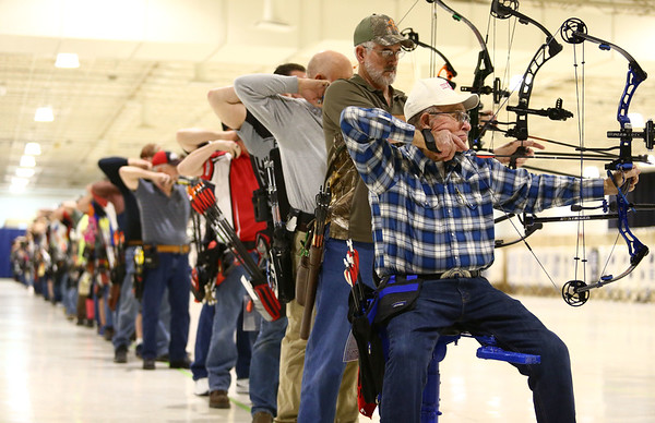 Dennis Bryant from Atlanta, Indiana sits as he draws his bow and aims at the target during the 53rd annual Indiana Field Archery Association Indoor Tournament at the Kokomo Event Center on Saturday, March 3, 2018.<br /> Kelly Lafferty Gerber | Kokomo Tribune