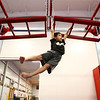 Ethan Pickett, 9, swings through the hand-over-hand bars, part of the Ninja Zone class at Kokomo Flipsters on Tuesday, March 13, 2018.<br /> Kelly Lafferty Gerber | Kokomo Tribune