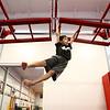 Ethan Pickett, 9, swings through the hand-over-hand bars, part of the Ninja Zone class at Kokomo Flipsters on Tuesday, March 13, 2018.<br /> Kelly Lafferty Gerber   Kokomo Tribune