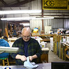 Glass artist Mark Jennings wipes off glass pieces before he starts making suncatchers for the Kokomo Opalescent Gift Shop on Tuesday, February 27. Earlier that month, Jennings fulfilled an order of 100 bunny suncatchers for the White House gift shop.<br /> Kelly Lafferty Gerber | Kokomo Tribune