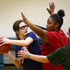 Sondra Prather looks for a pass over Shantina Holiday as the Howard County Special Olympics girls basketball team practices on Tuesday, March 6, 2018.<br /> Kelly Lafferty Gerber | Kokomo Tribune
