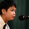 Maconaquah Middle-schooler James Yang leans into the microphone to spell a word during the North Central Indiana Regional Spelling Bee at IUK on Thursday, March 22, 2018.<br /> Kelly Lafferty Gerber | Kokomo Tribune