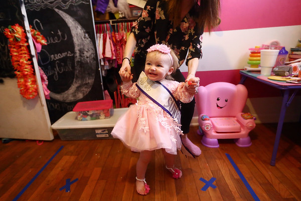 "One-and-a-half-year-old Aria Bass dances to ""Can't Stop the Feeling"" as her mom Haylee Bass holds her hands and walks her around the taped marks on Aria's bedroom floor on February 8, 2018. The pair rehearse the dancing at home prior to Aria's stage debut at the pageants.<br /> Kelly Lafferty Gerber 