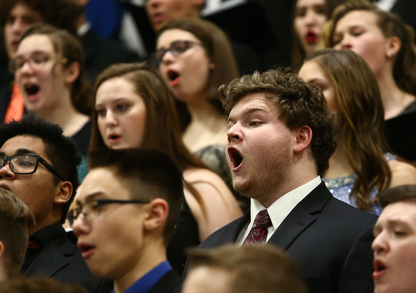 Western's Justin Kline sings alongside other choir members from Eastern, Western, Northwestern and Taylor as they perform together during the Howard County Music Festival at Eastern High School on Wednesday, March 14, 2018.<br /> Kelly Lafferty Gerber | Kokomo Tribune