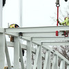 Construction crews work on installing the $2 million pedestrian bridge that will connect the Nickel Plate trail to downtown Kokomo on Wednesday morning, March 28, 2018.<br /> Kelly Lafferty Gerber | Kokomo Tribune