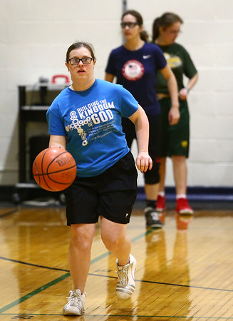 Kylea Cogdell warms up with the Howard County Special Olympics girls basketball team during practice on Tuesday, March 6, 2018.<br /> Kelly Lafferty Gerber | Kokomo Tribune