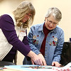 Gail Myers, left, works with Marcia Ford with sewing washable hygiene solutions for girls during their monthly menstrual cycles on International Women's Day, Thursday, March 8, 2018.<br /> Kelly Lafferty Gerber | Kokomo Tribune