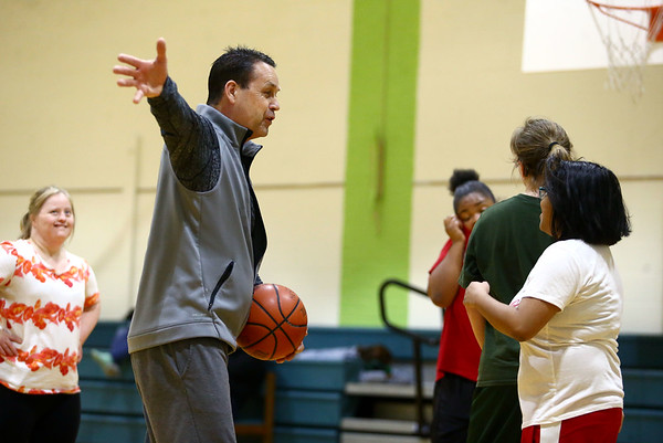 Howard County Special Olympics girls basketball team's head coach Kevin Ackison gives pointers to players during practice on Tuesday, March 6, 2018.<br /> Kelly Lafferty Gerber | Kokomo Tribune