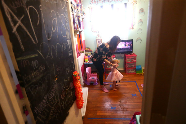 Aria Bass, who is now one-and-a-half-year-old, has been competing in pageants since she was born. With the aid of her mom Haylee, Aria practices her dance moves in her bedroom on February 8, 2018.<br /> Kelly Lafferty Gerber | Kokomo Tribune