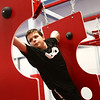 11-year-old Sam Summerfield reaches for the next swiss cheese wall as he makes his way through the course during the Ninja Zone class at Kokomo Flipsters on Tuesday, March 13, 2018.<br /> Kelly Lafferty Gerber | Kokomo Tribune