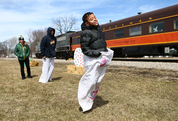 Landon Hall, 7, leads the way during a bunny hop sack race after the Bunny Hop Express makes a stop in Walton on Sunday, March 25, 2018.<br /> Kelly Lafferty Gerber | Kokomo Tribune