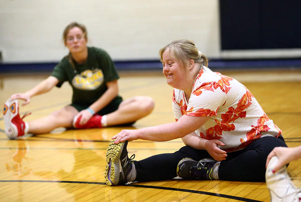 Kerrie Steele stretches as she warms up for the Howard County Special Olympics girls basketball team practice on Tuesday, March 6, 2018.<br /> Kelly Lafferty Gerber | Kokomo Tribune