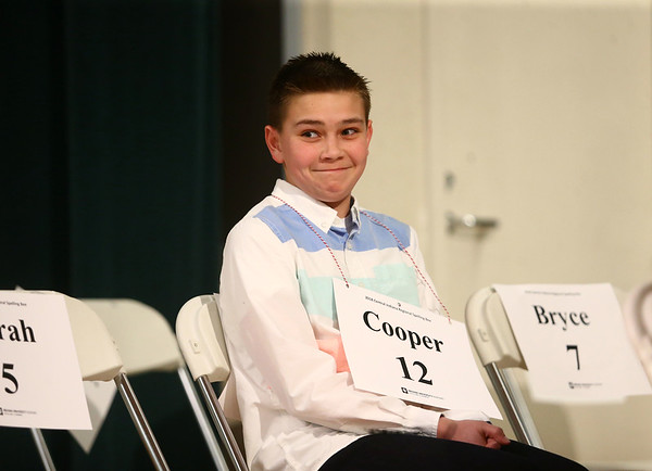 Northwestern Elementary student Cooper Deck smiles back at his family in the audience once he takes a seat after correctly spelling a word during the North Central Indiana Regional Spelling Bee at IUK on Thursday, March 22, 2018.<br /> Kelly Lafferty Gerber   Kokomo Tribune