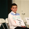 Northwestern Elementary student Cooper Deck smiles back at his family in the audience once he takes a seat after correctly spelling a word during the North Central Indiana Regional Spelling Bee at IUK on Thursday, March 22, 2018.<br /> Kelly Lafferty Gerber | Kokomo Tribune