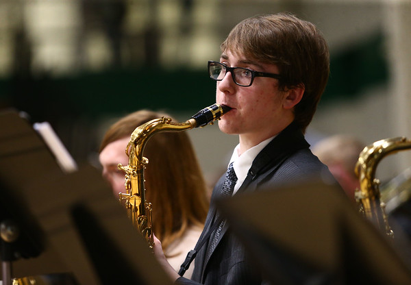 Northwestern's Jared Melton plays the saxophone alongside the Eastern, Western, Northwestern and Taylor High Schools' bands at the Howard County Music Festival at Eastern High School on Wednesday, March 14, 2018.<br /> Kelly Lafferty Gerber | Kokomo Tribune