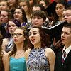 Northwestern's Tessa Weidner, front, sings with choirs from Eastern, Western, Northwestern and Taylor High Schools as they perform together during the Howard County Music Festival at Eastern High School on Wednesday, March 14, 2018.<br /> Kelly Lafferty Gerber | Kokomo Tribune