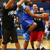 Bona Vista All Stars' Craig Simmons heads to the basket as Celebrity team member Torrey Roe puts up the block during the Disability Awareness Basketball game at Memorial Gym on Tuesday, March 20, 2018. <br /> Kelly Lafferty Gerber | Kokomo Tribune
